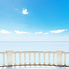 White balcony on terrace near sea and blue sky | Stock Foto