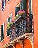 Picturesque balcony with flowers in an old Italian | Stock Foto