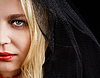 Portrait of blonde young woman in black veil | Stock Foto