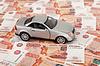 Spielzeugauto auf Hintergrund des russisch-Banknoten | Stock Foto