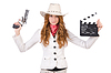 Young cowgirl with gun and movie board | Stock Foto