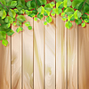 Green leaves on wood texture. background | Stock Vector Graphics