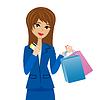 Frau mit Kreditkarte und Einkäufe in den Händen