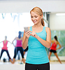Sporty woman with smartphone | Stock Foto