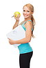 Sporty woman with scale and green apple | Stock Foto