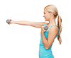 Young sporty woman with light dumbbells | Stock Foto