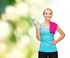 Sporty woman with towel and watel bottle | Stock Foto