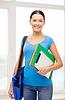 ID 4449018 | Student z folderów, tablet PC i torbę w szkole | Foto stockowe wysokiej rozdzielczości | KLIPARTO