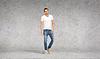 ID 4464162 | Smiling young man in white t-shirt | Foto stockowe wysokiej rozdzielczości | KLIPARTO