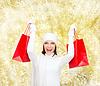 ID 4483923 | Smiling young woman with red shopping bags | Foto stockowe wysokiej rozdzielczości | KLIPARTO