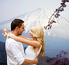 Happy couple hugging over japan mountains | Stock Foto