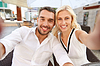 Happy couple taking selfie at restaurant terrace | Stock Foto