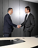 Serious businessmen shaking hands | Stock Foto