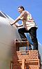 ID 4333992 | Man looks into airplane cabin | Foto stockowe wysokiej rozdzielczości | KLIPARTO
