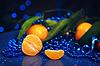 ID 4147956 | Mandarinen auf dunkelblauem Hintergrund - Neujahr | Foto mit hoher Auflösung | CLIPARTO