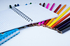 Stack of colored pencils with notebook | Stock Foto