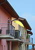 Yellow parasol on balcony with colorful house | Stock Foto