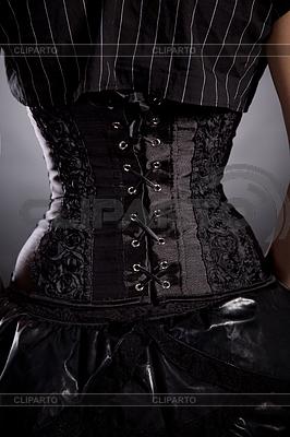 Back view of woman in black rose corset | Foto stockowe wysokiej rozdzielczości |ID 4474275
