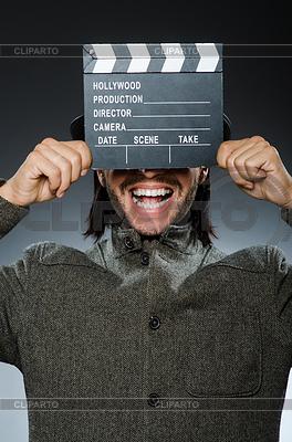 Mann mit Filmklappe und Hut | Foto mit hoher Auflösung |ID 4433349