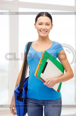 Student z folderów, tablet PC i torbę w szkole | Foto stockowe wysokiej rozdzielczości |ID 4449018