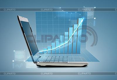 Laptop computer with chart | Foto stockowe wysokiej rozdzielczości |ID 4451910